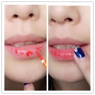 眼妆的画法  10,然后用手指指腹将其向外铺开在唇部