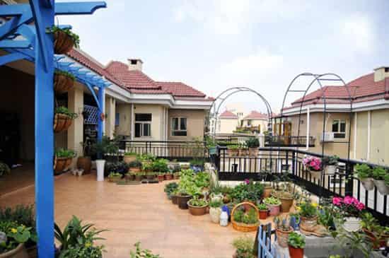 家庭屋顶花园设计效果图片欣赏 在家做个幸福小园丁
