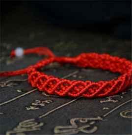 红绳怎么打结可以伸缩 红绳手链可以戴着洗澡吗