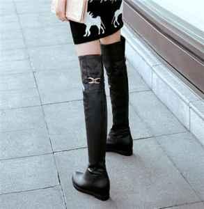 长筒靴配牛仔裤好看吗